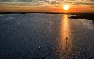 Sunset drone flight over lake Gooimeer