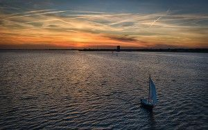 Sailing boat during sunset on lake Gooimeer