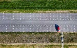 Top-down drone picture of an almost empty parking lot