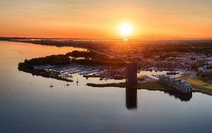 Drone panorama of sailing boats on lake Gooimeer during sunset