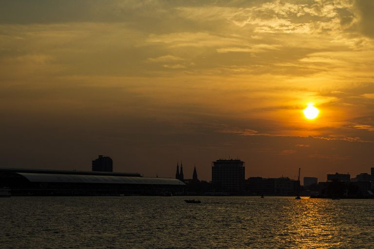 Sunset over the IJ river in Amsterdam
