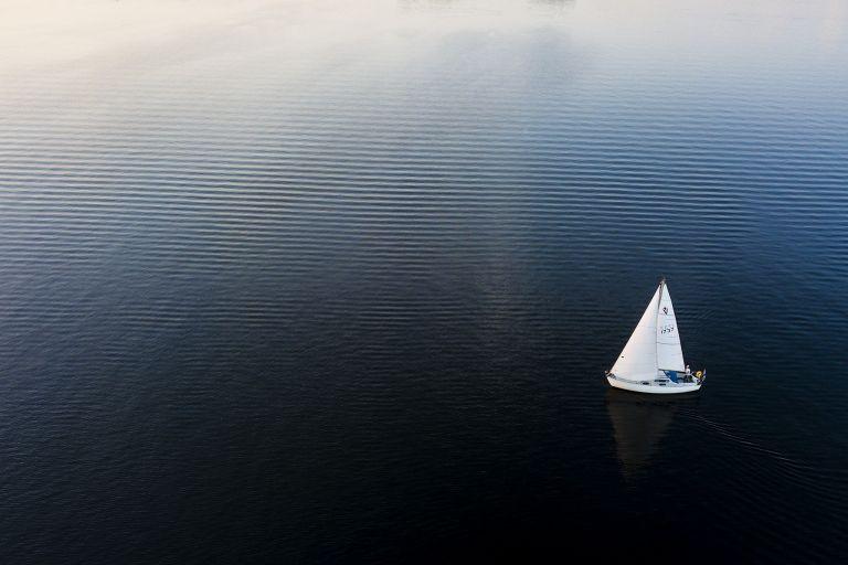 Sailing boat during sunset on lake Gooimeer