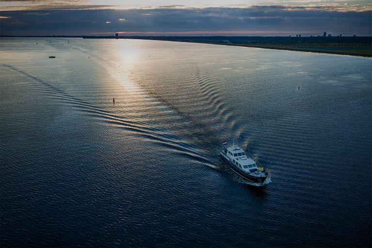 Motor boat cruising over lake Gooimeer