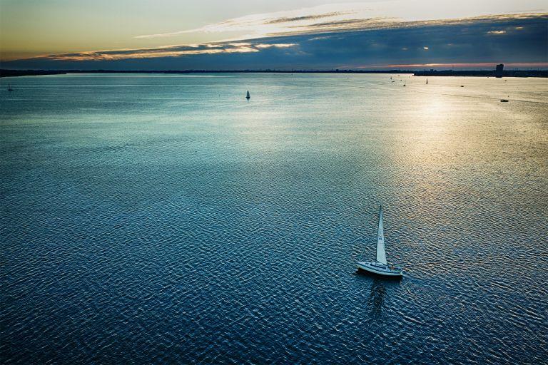 Sailing on lake Gooimeer during sunset