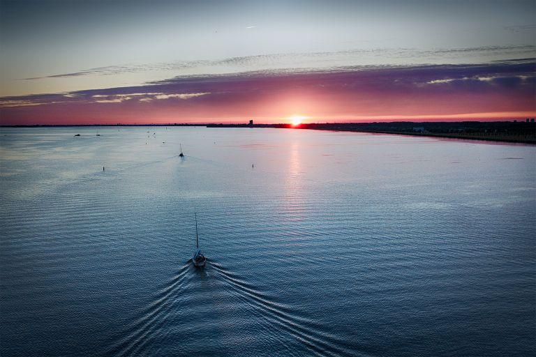 Sailing home on lake Gooimeer during sunset
