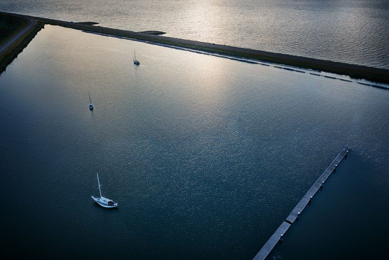 Boats at Oostvaardersdiep during sunset