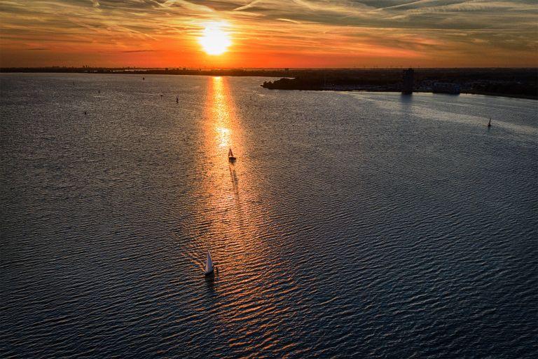 Sailing boat during sunset on lake Gooimeer during sunset