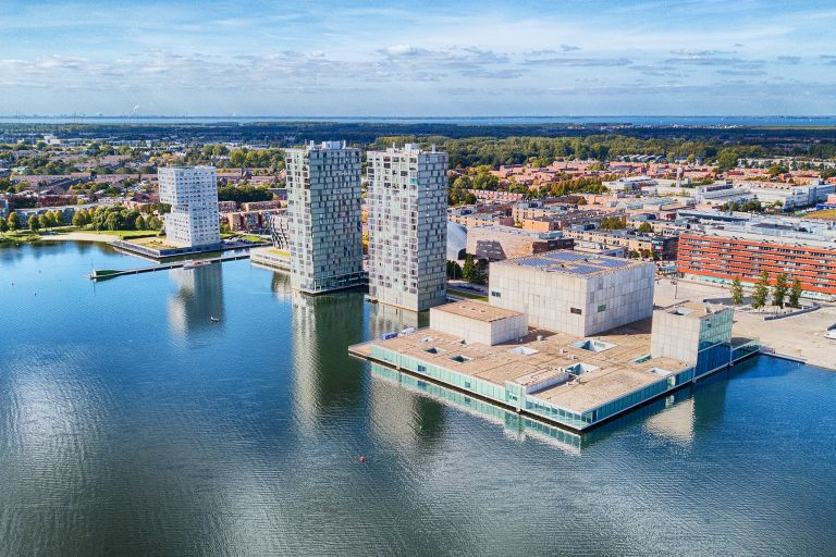 Almere city centre by drone next to lake Weerwater