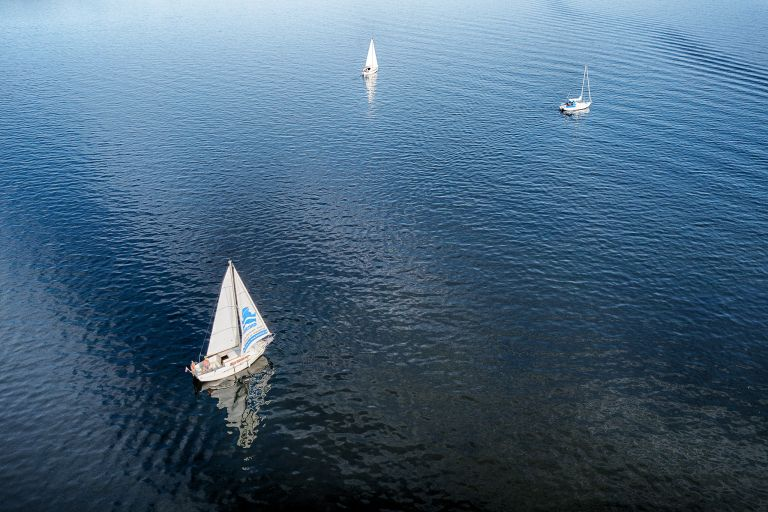 Drone picture of sailing boats on lake Gooimeer