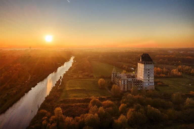 Orange sunset glow at Almere castle
