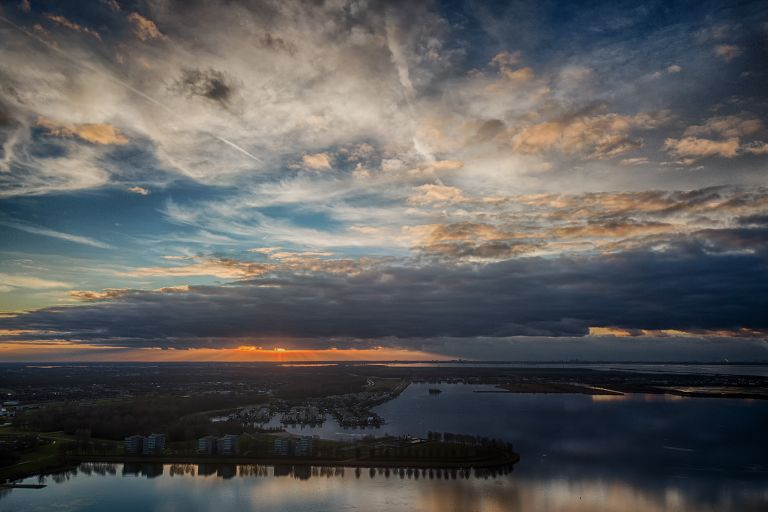 Cloudy drone sunset