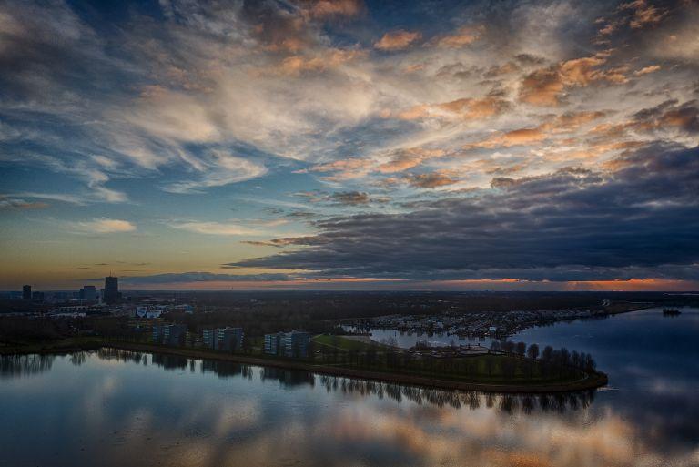 Cloudy sunset over lake Noorderplassen