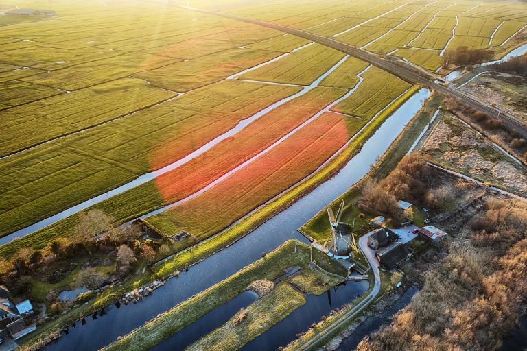 Drone sunset over the fields near Weesp