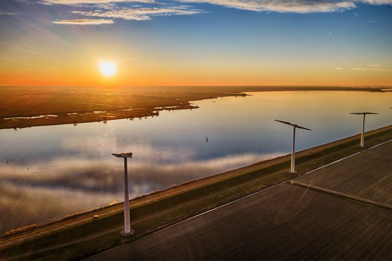Sunset drone picture of windmills on Eemmeerdijk