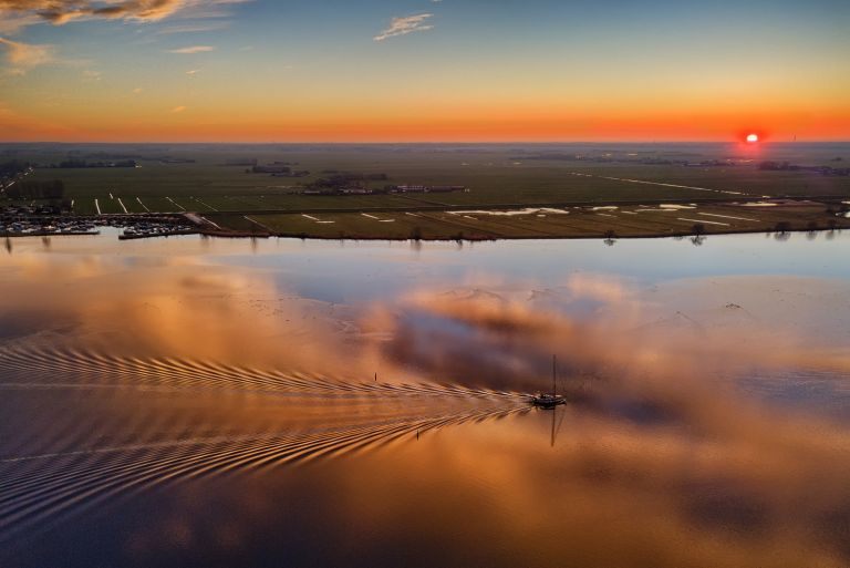 Drone picture of lake Eemmeer during sunset