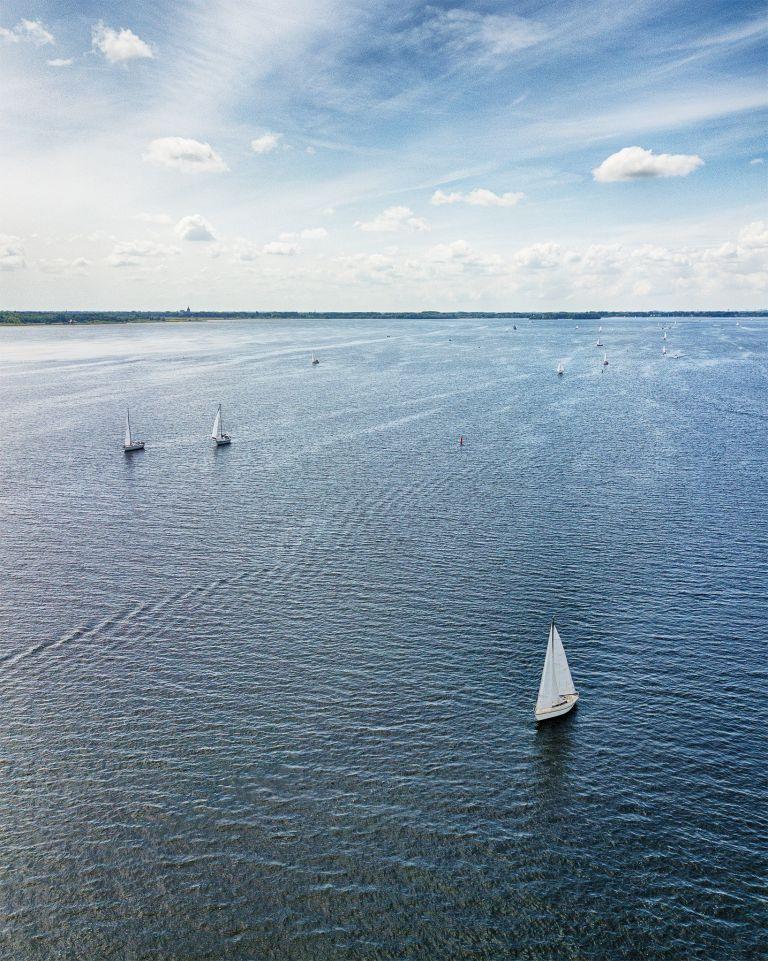 Sailing boats on lake Gooimeer