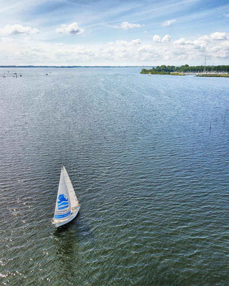 Sailing boat on lake Gooimeer