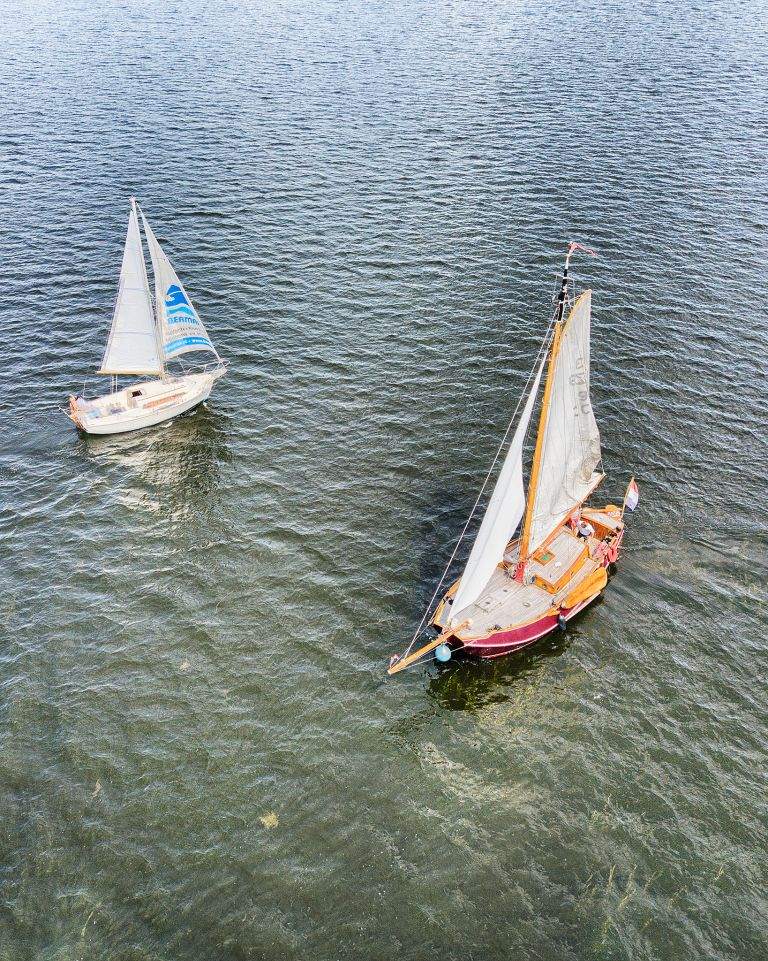 Sailing boats on lake Gooimeer