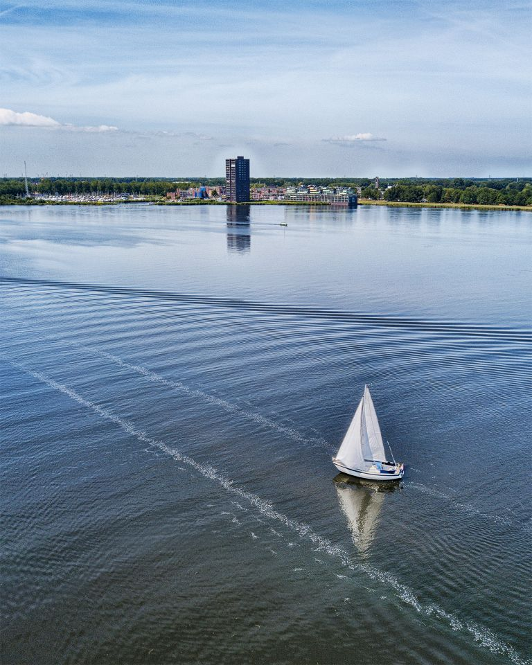 Drone picture of sailing boat on lake Gooimeer