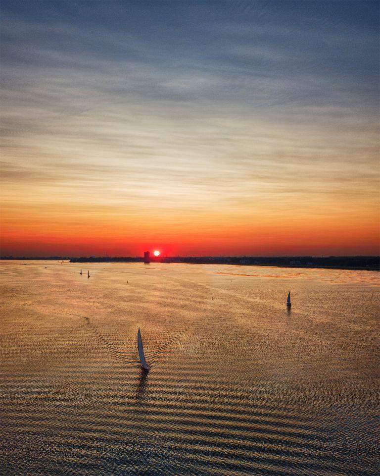 Sailing during sunset on lake Gooimeer