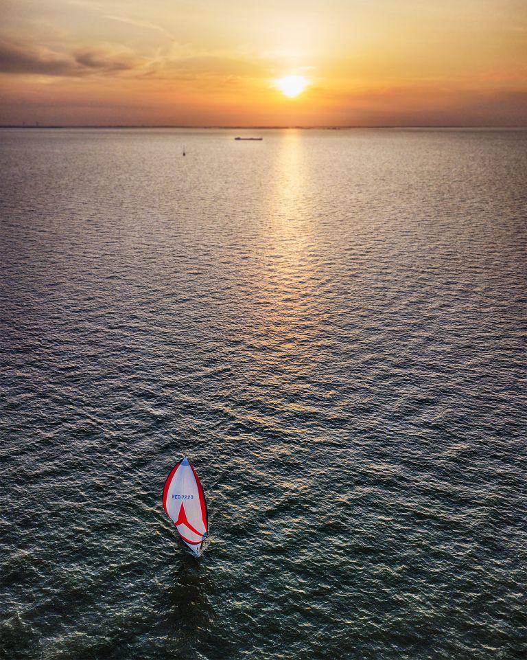 Sailing on lake Markermeer during sunset