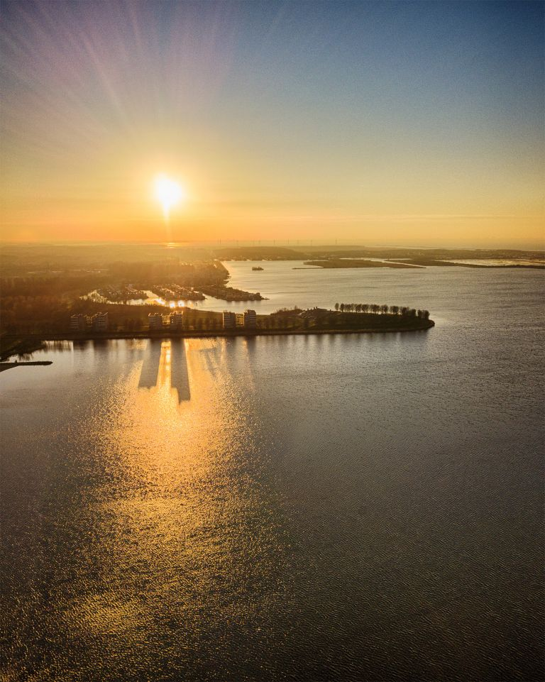 Drone sunset over lake Noorderplassen