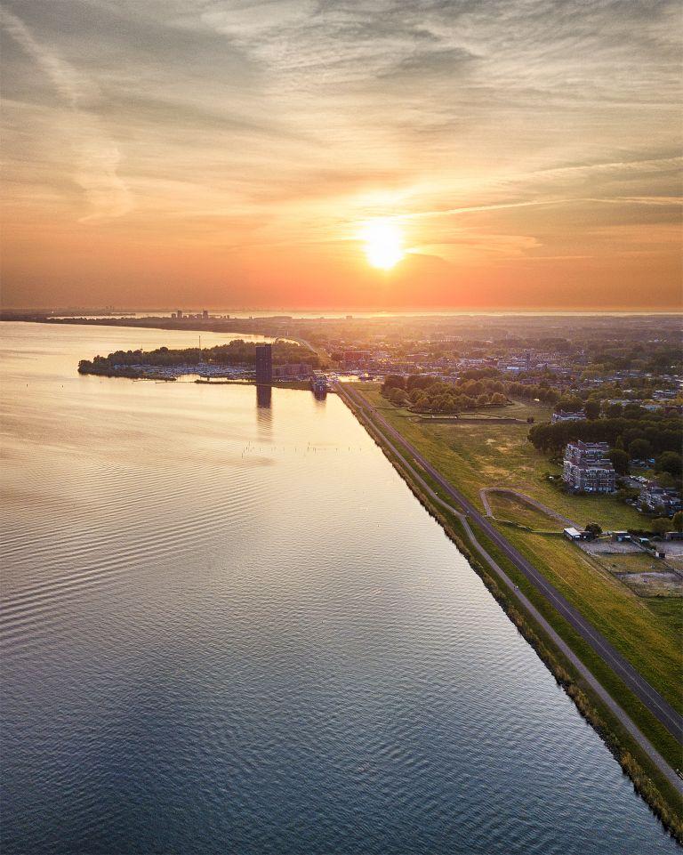 Drone sunset over lake Gooimeer