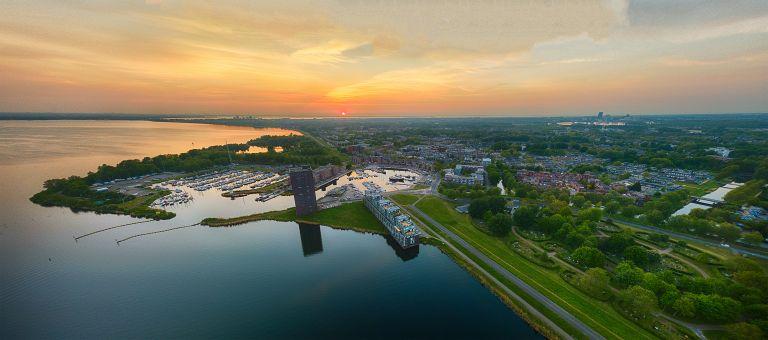 Drone sunset panorama over lake Gooimeer